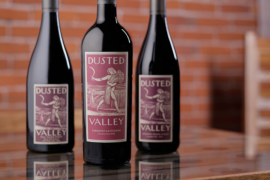 Dusted Valley wine bottles on a table (Small)